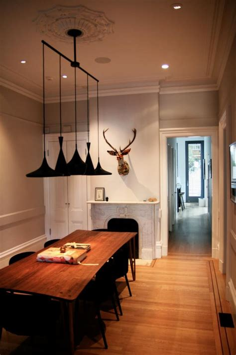Transitional Dining Room With Hanging Light Fixture