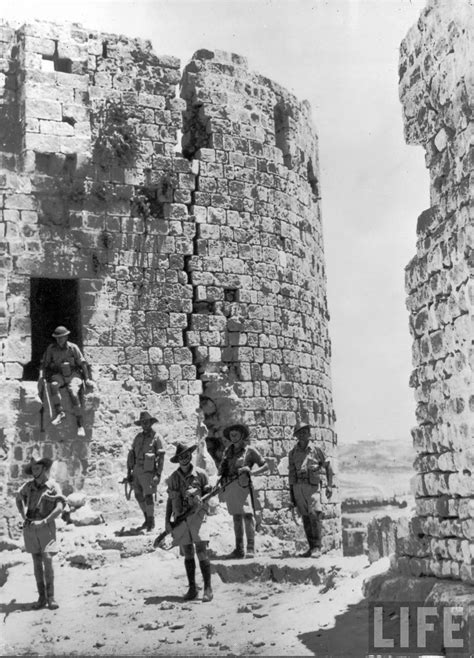 Australian troops searching for Vichy French snipers