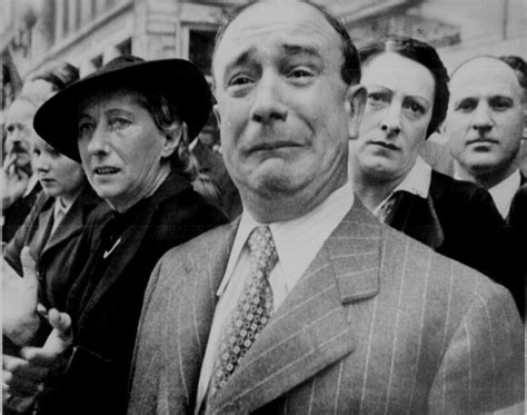 A Frenchman Weeps as Nazi Soldiers March in Paris, France