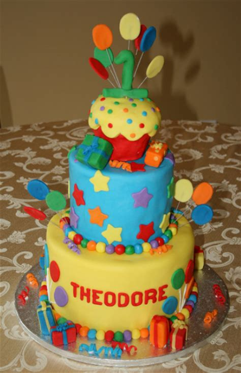 Beautiful big first birthday cake with balloons and gifts
